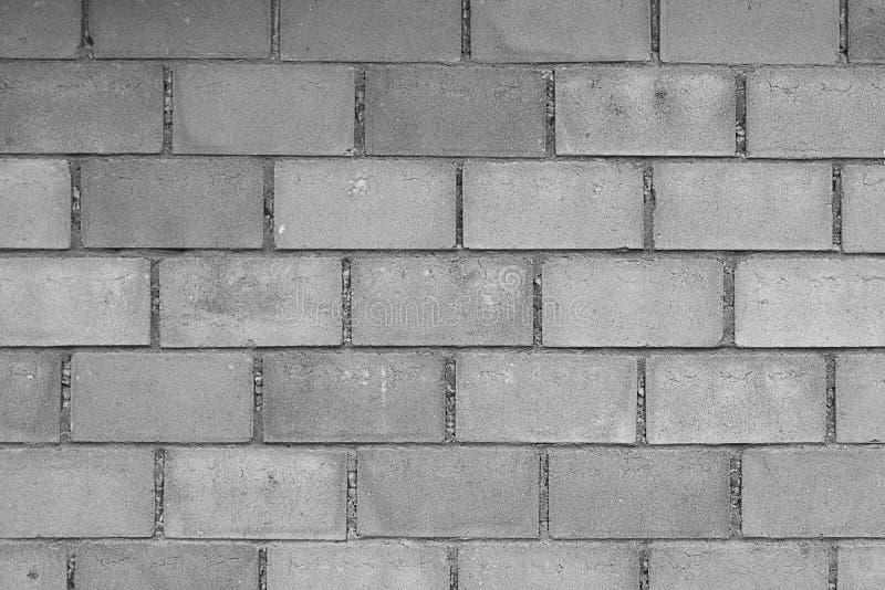 Fondo della parete del blocco in calcestruzzo in bianco e nero immagine stock