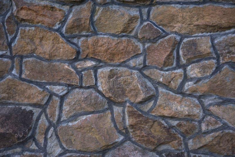 Fondo della parete della facciata dell'ardesia della muratura fotografia stock
