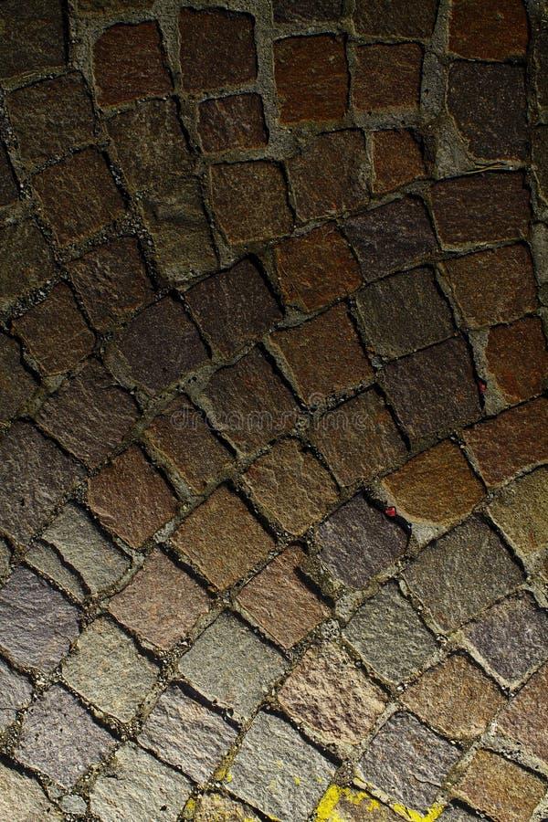 Fondo della pavimentazione della via, struttura della roccia, livello di superficie della pietra fotografia stock libera da diritti