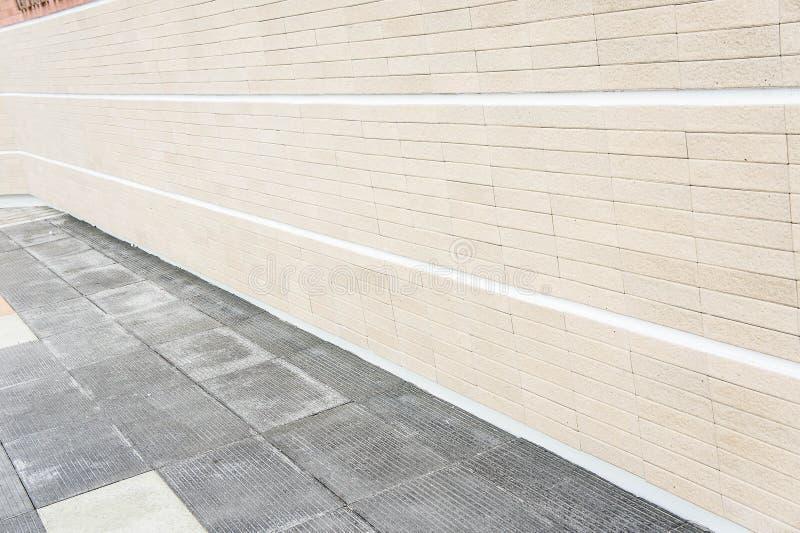 Fondo della pietra del marciapiede della parete di struttura fotografia stock libera da diritti