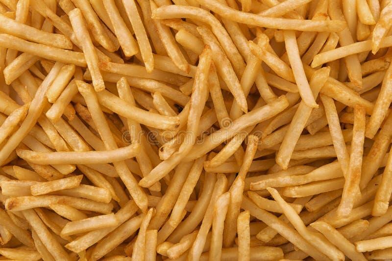 Fondo della pila di patate fritte croccanti fotografia stock libera da diritti