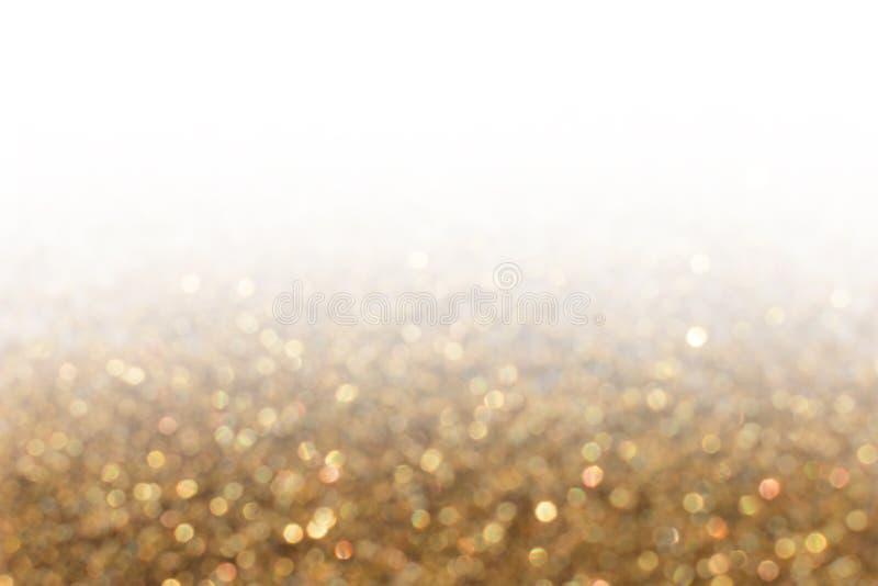 Fondo della sfuocatura di pendenza dell'oro delle luci di scintillio Tex variopinto del bokeh fotografia stock
