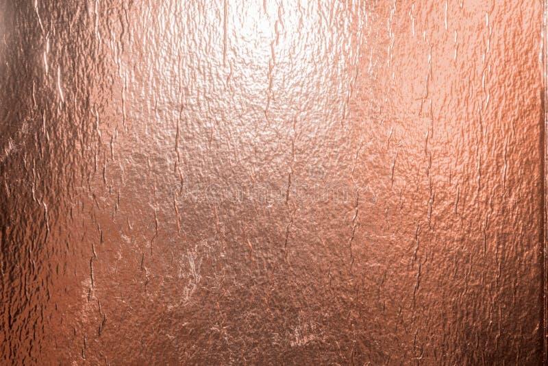 Fondo della stagnola di Rose Gold immagini stock