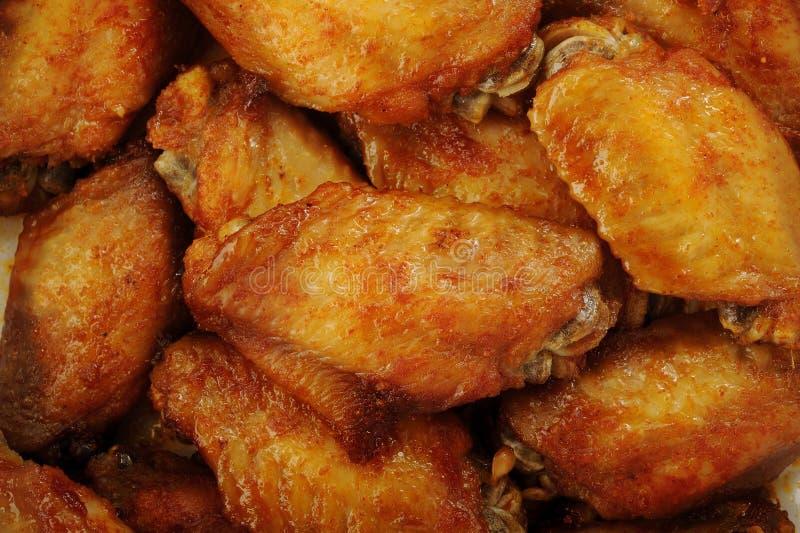 Fondo delle ali di pollo fotografie stock