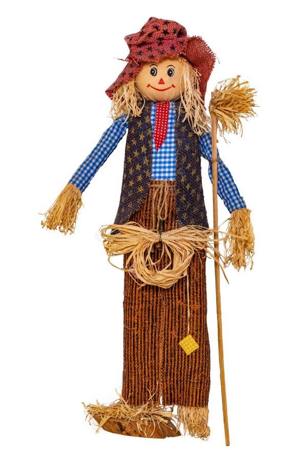 Fondo delle decorazioni della paglia Primo piano di una bambola fatta a mano divertente dello spaventapasseri isolata su fondo bi fotografie stock libere da diritti