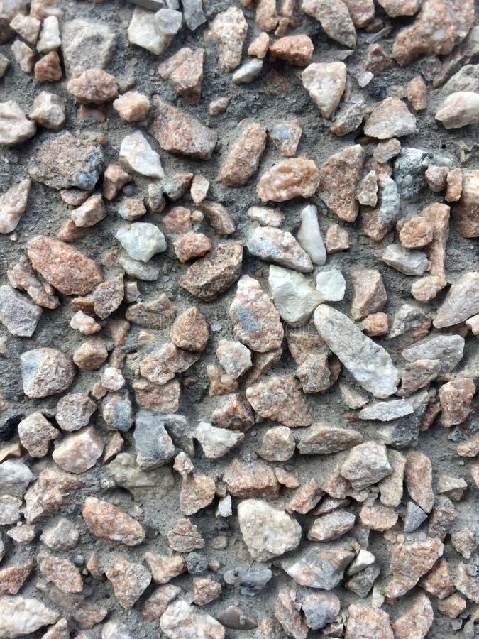 Fondo delle pietre nella struttura del muro di cemento immagine stock