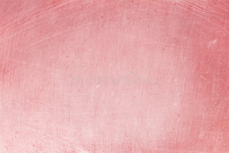 Fondo di alluminio di struttura con colore rosa dell'oro, modello dei graffi su acciaio inossidabile immagini stock
