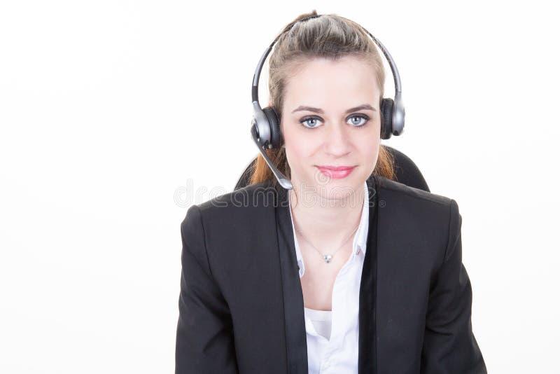 Fondo di bianco di Wearing Headset Isolated della donna di affari fotografia stock libera da diritti