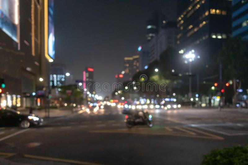 Fondo di Bokeh, città alla notte fotografie stock
