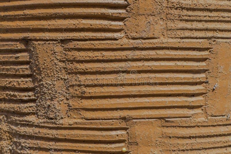 Fondo di Brown, forma di arte dell'argilla immagini stock