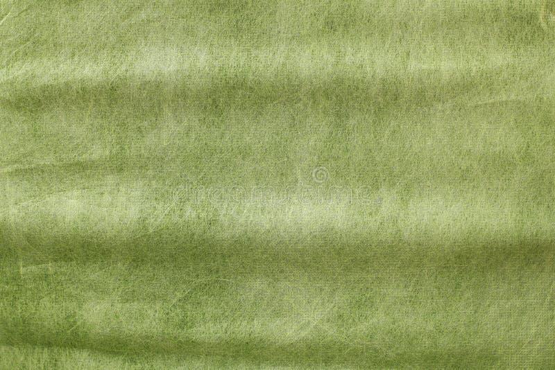 Fondo di carta ondulato di struttura di pendenza verde fotografie stock libere da diritti