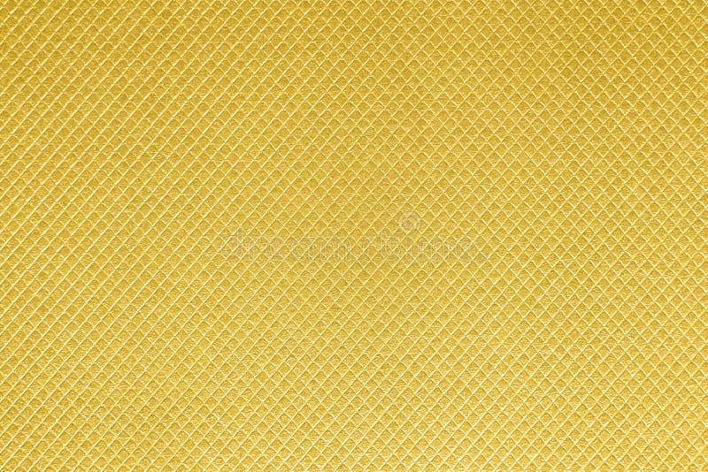 Fondo di carta strutturato con gli effetti di superficie dell'oro fotografia stock libera da diritti