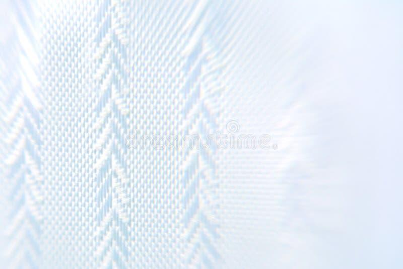 Fondo di colore blu con struttura geometrica di tessuto sotto forma di abete rosso fotografia stock