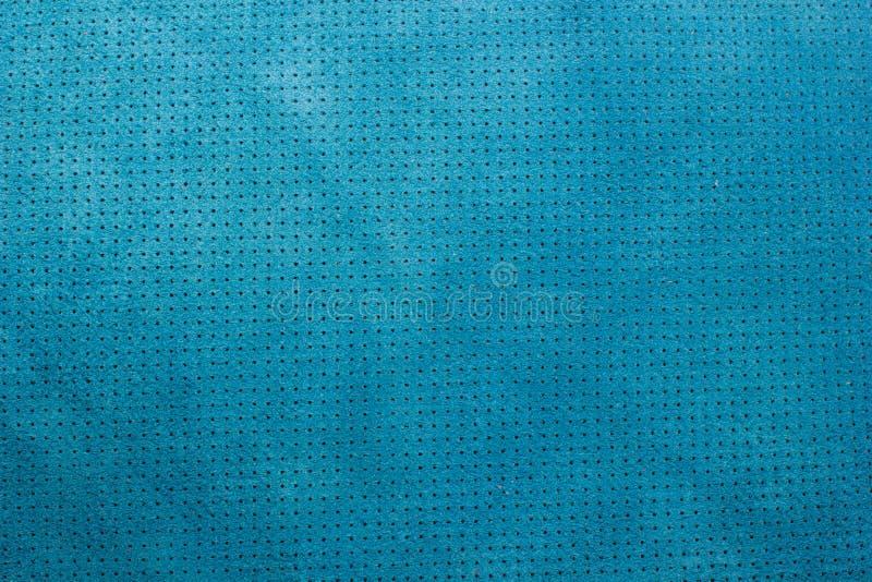 Fondo di cuoio perforato di struttura del velluto blu fotografie stock