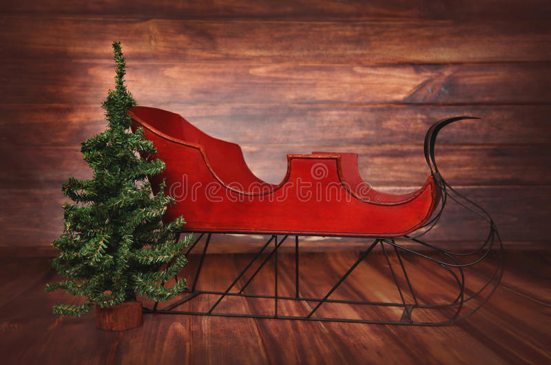 Fondo di fotografia digitale del Natale d'annata rosso Sleigh immagini stock