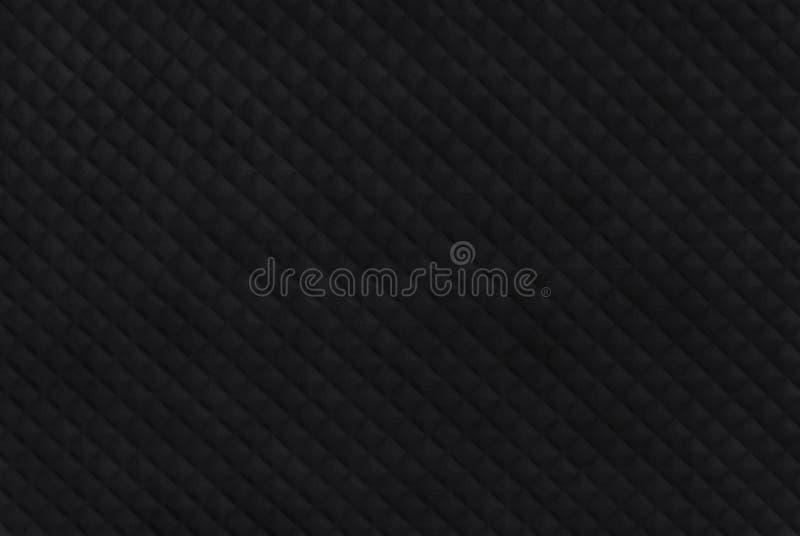 Fondo di gomma nero di struttura con il modello senza cuciture fotografia stock