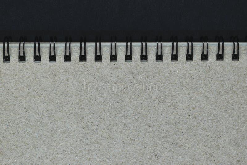 Fondo di Grey Notebook Cover con le spirali nere del metallo con lo spazio della copia libera immagine stock libera da diritti