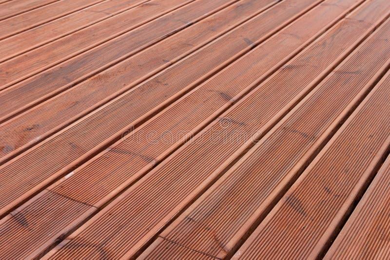 Fondo di legno bagnato del pavimento del terrazzo immagine for Disegni unici del pavimento