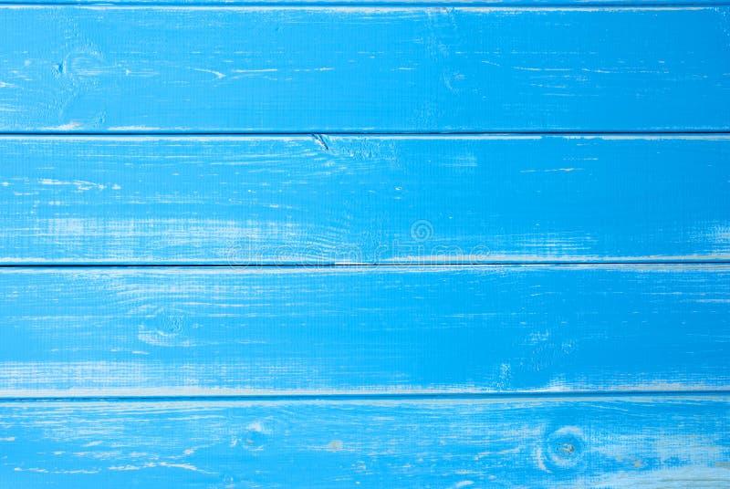 Fondo di legno blu-chiaro, spazio della copia fotografie stock