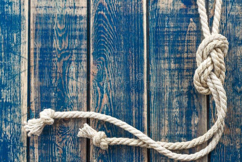 Fondo di legno con il nodo marino fotografie stock
