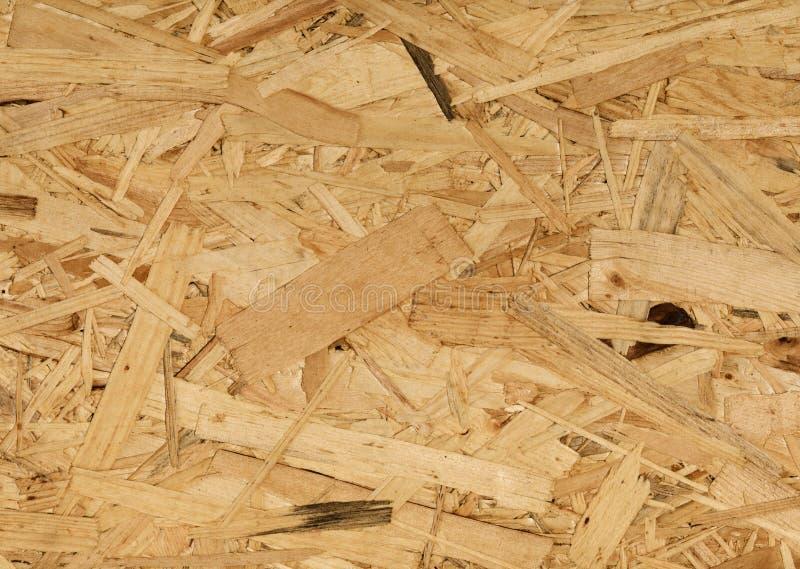 Fondo di legno di Osb, disposizione piana dei piccoli pezzi fotografia stock libera da diritti