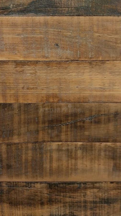 Fondo di legno di struttura con i colori ricchi Toni arancio, marroni e scuri fotografie stock