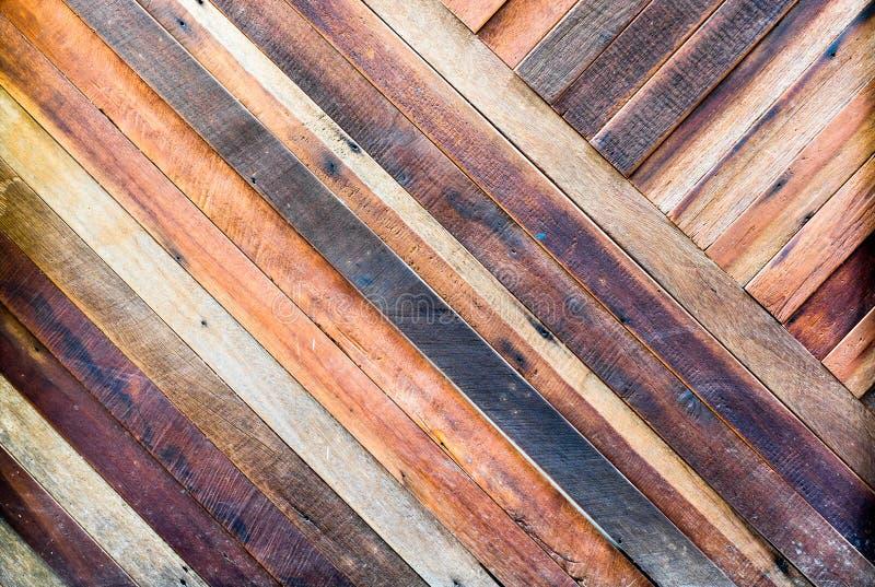 Fondo di legno di struttura della plancia pallida, parete diagonale di allineamento fotografie stock