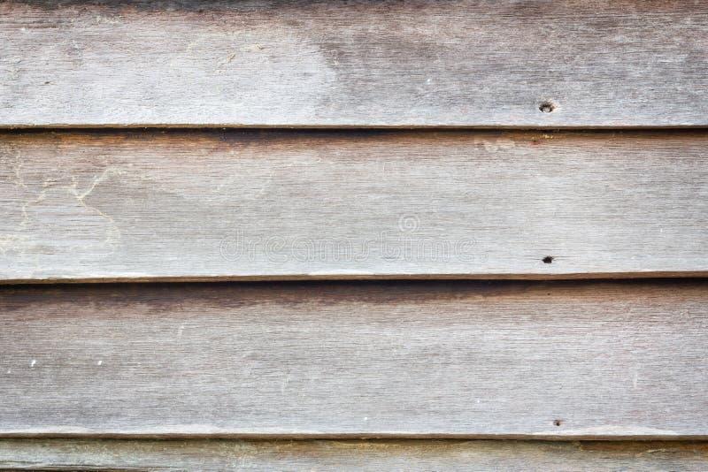 Fondo di legno marrone Grungy di struttura della parete della plancia fotografia stock libera da diritti