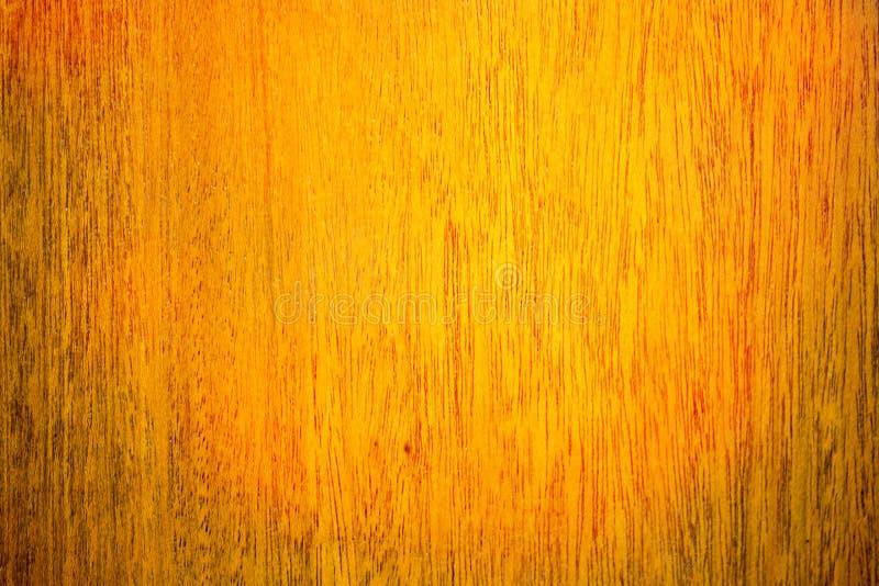 Fondo di legno di struttura con il modello naturale in arancia e nel marrone fotografia stock