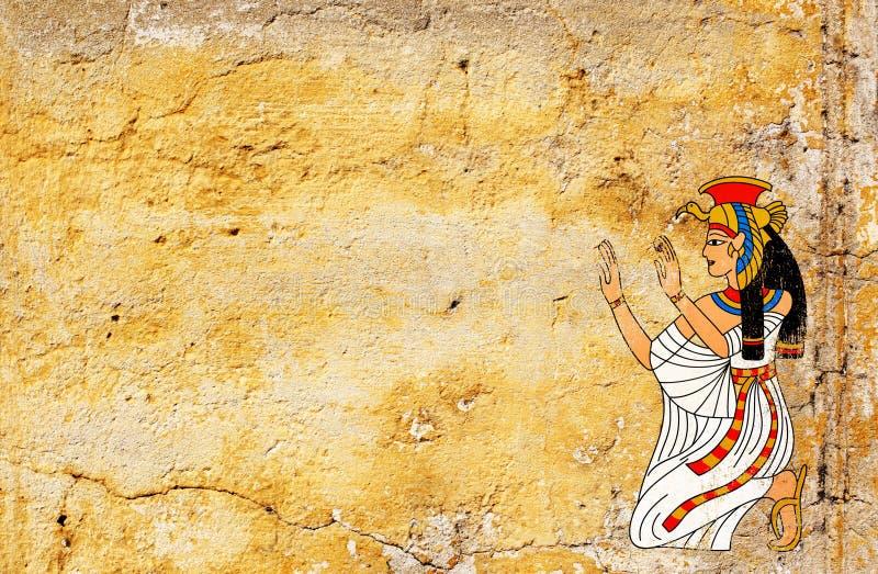 Fondo di lerciume con vecchia struttura dello stucco e la dea egiziana I immagini stock