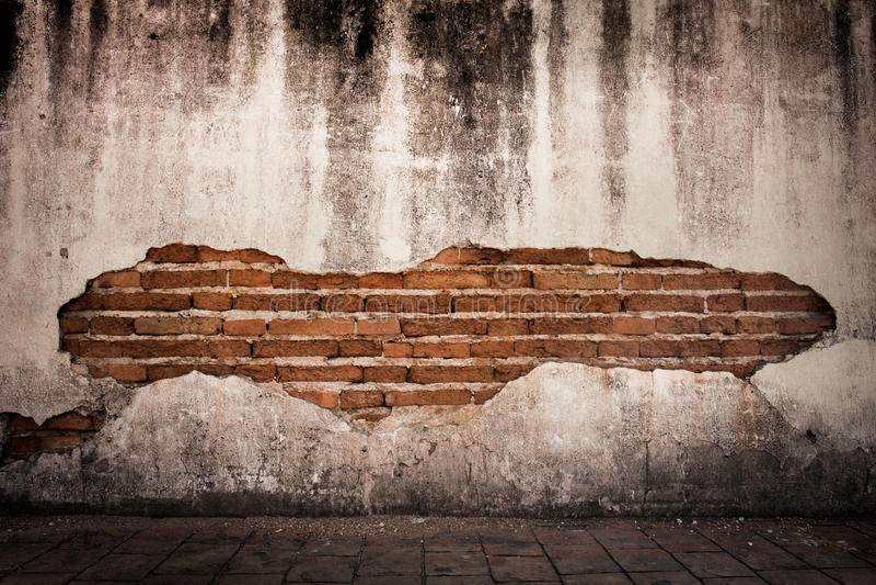 fondo di lerciume, parete luminosa del gesso di struttura rossa del muro di mattoni immagine stock