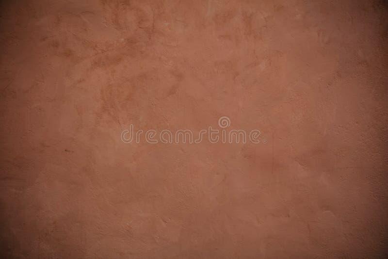 Fondo di lerciume di struttura della parete dipinto stucco di Brown fotografia stock libera da diritti