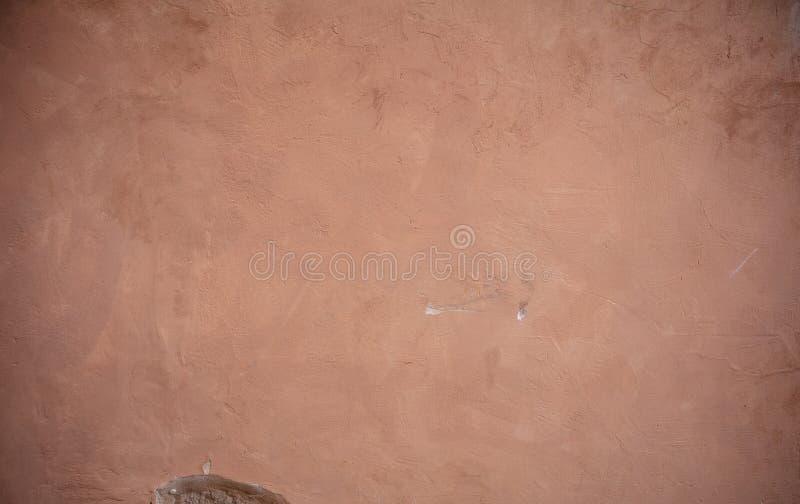 Fondo di lerciume di struttura della parete dipinto stucco di Brown fotografia stock