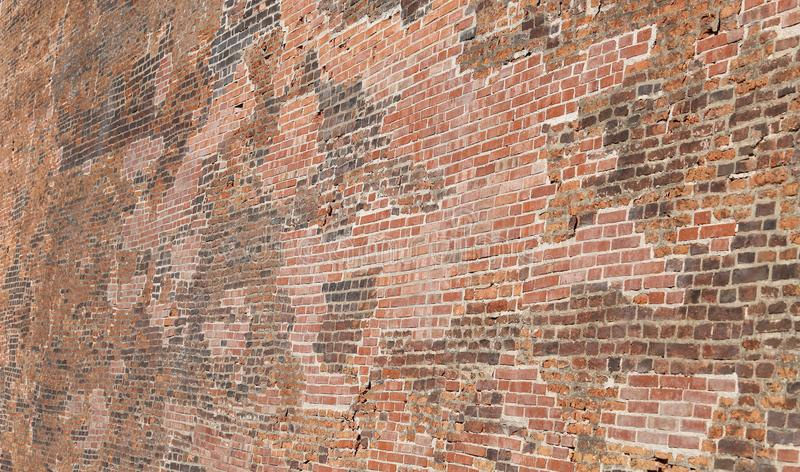 Fondo di migliaia di mattoni rossi di grande parete fotografie stock libere da diritti