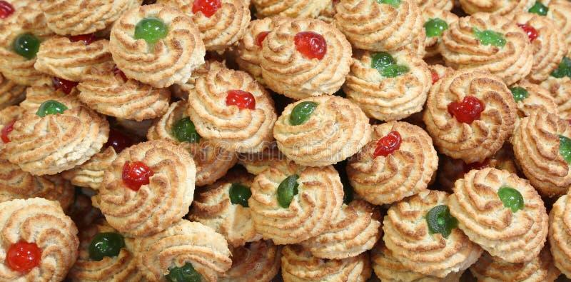 fondo di molti biscotti con la ciliegia fotografie stock libere da diritti
