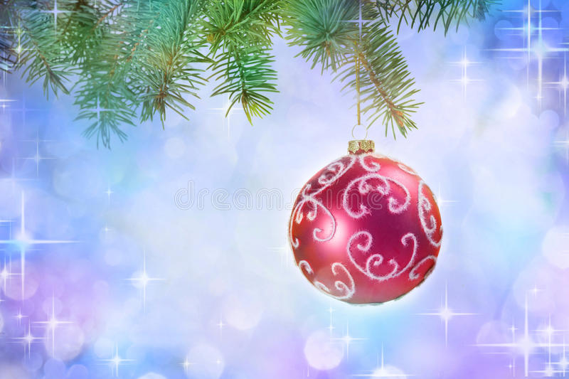 Fondo di Natale con la palla e le luci immagine stock