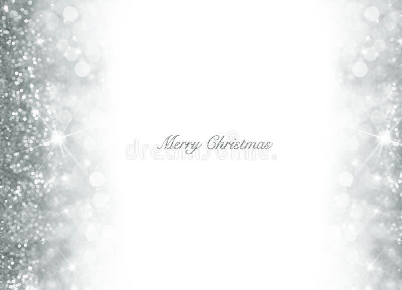Fondo di Natale di Bokeh con scintillio d'argento immagini stock