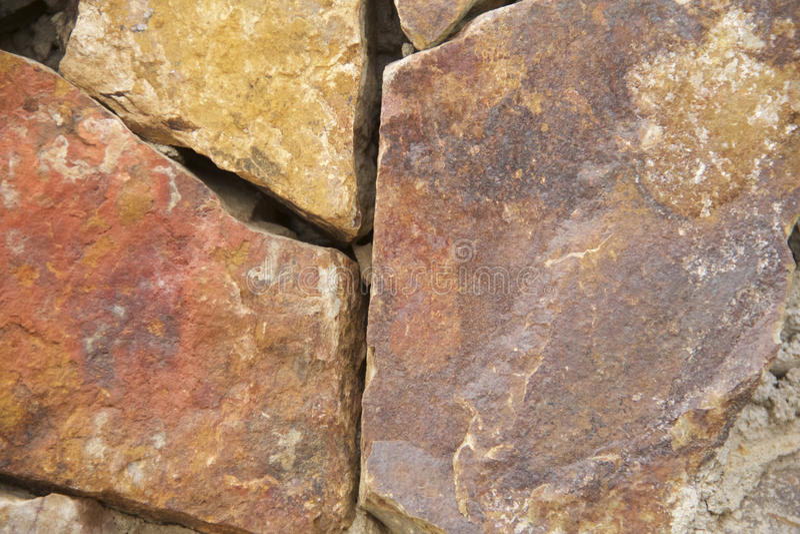 Fondo di pietra incrinato approssimativo arancio di struttura immagini stock libere da diritti