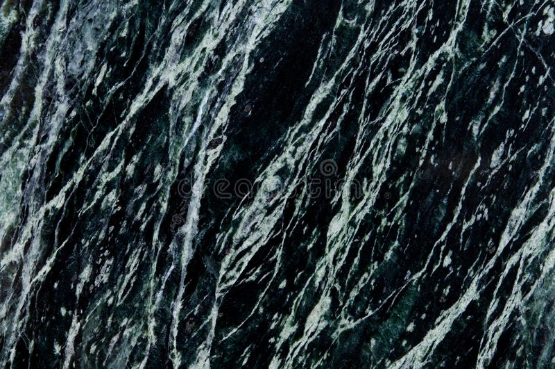 Fondo di pietra di marmo verde scuro e nero Marmo nero o verde scuro, struttura del quarzo Modello naturale del marmo del pannell fotografia stock libera da diritti