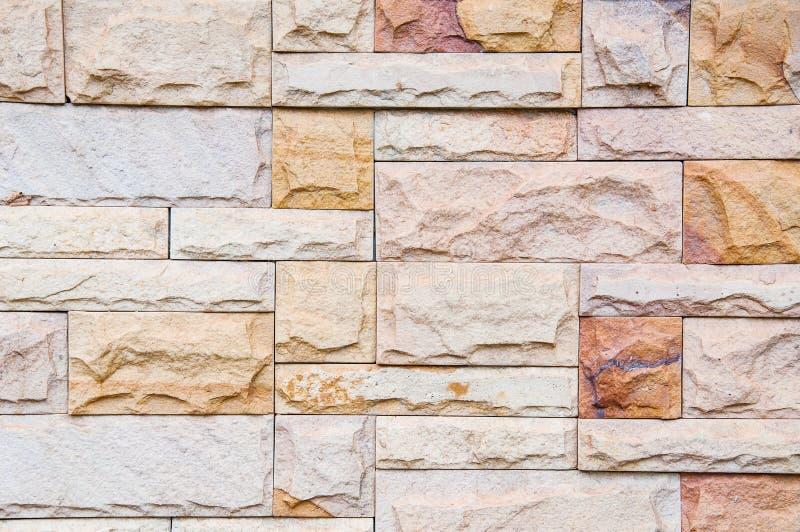 Fondo di pietra moderno del muro di mattoni fotografie stock
