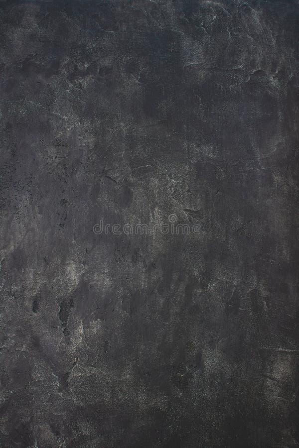 Fondo di pietra scuro di struttura Contesto della parete di lerciume fotografia stock libera da diritti