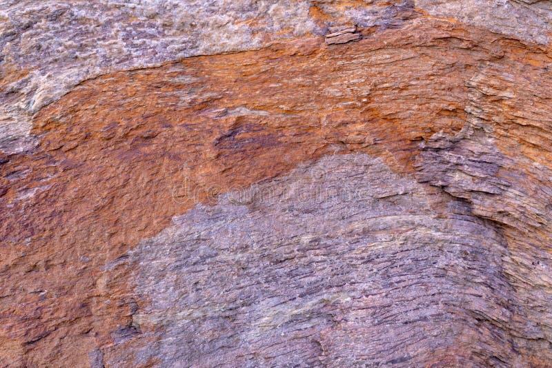 Fondo di pietra di struttura con il modello unico Brown e struttura sporca grigia della roccia Fondo astratto di superficie della fotografie stock libere da diritti