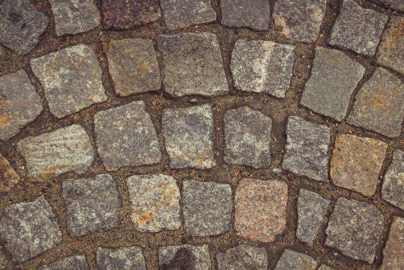 Fondo di pietra struttura della pietra, ciottolo, pavimentazione, granito fotografia stock