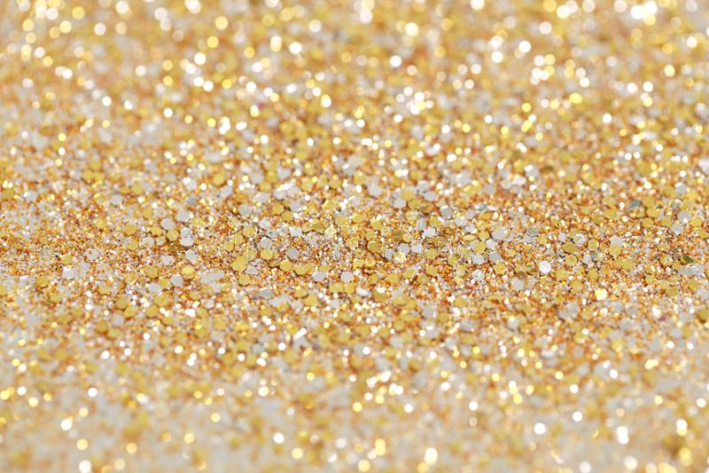 Fondo di scintillio dell'oro e dell'argento del nuovo anno di Natale Struttura astratta di festa fotografia stock libera da diritti