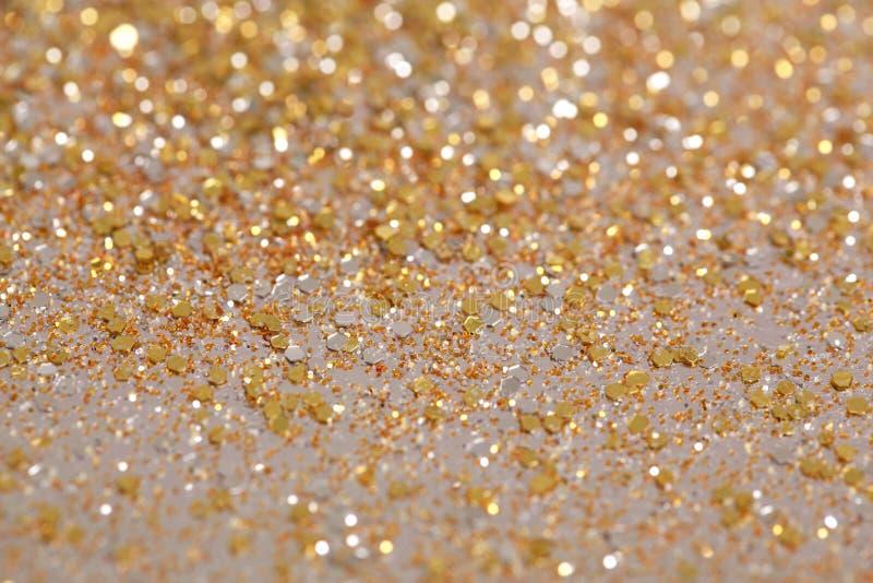 Fondo di scintillio dell'oro e dell'argento del nuovo anno di Natale Struttura astratta di festa fotografie stock libere da diritti