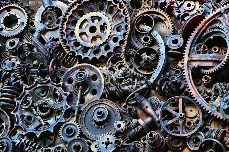 Fondo di Steampunk, pezzi meccanici, grandi ingranaggi e catene dalle macchine e dai trattori immagini stock