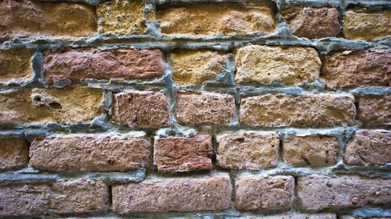 Mattoni di pietra colorati come fondo fotografie stock
