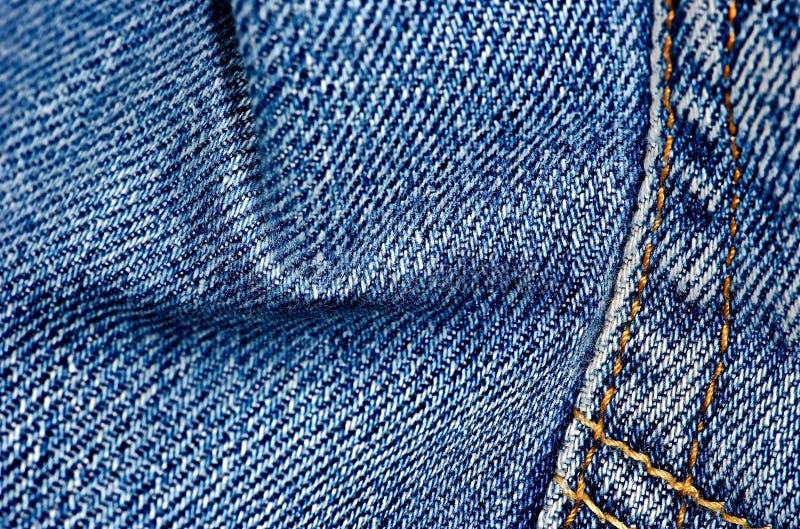 Fondo di struttura dei jeans del denim La struttura del tessuto di cotone colorato Fondo cucito dei jeans di struttura immagini stock libere da diritti