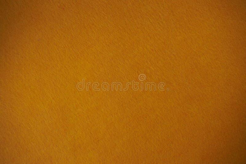 Fondo di struttura del feltro dell'arancia il tessuto isolato immagini stock