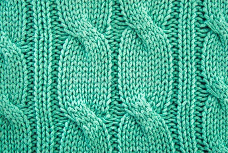 Fondo di struttura del maglione tricottato verde immagini stock libere da diritti